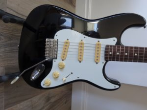 The neck date is 7-7-84. It has the Fender logo on the head and MADE IN JAPAN on the back of the neck.