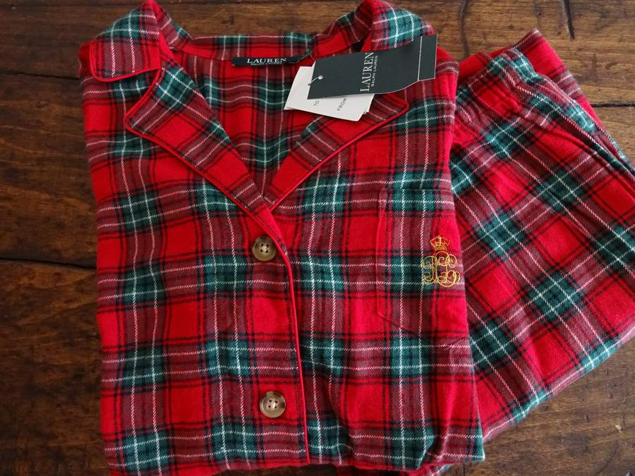 96cc425d3282b Cozy 2 piece long sleeved cotton flannel pajama set from the Ralph Lauren...  featuring a classic red and green tartan plaid. Classic styling... shirt  with ...