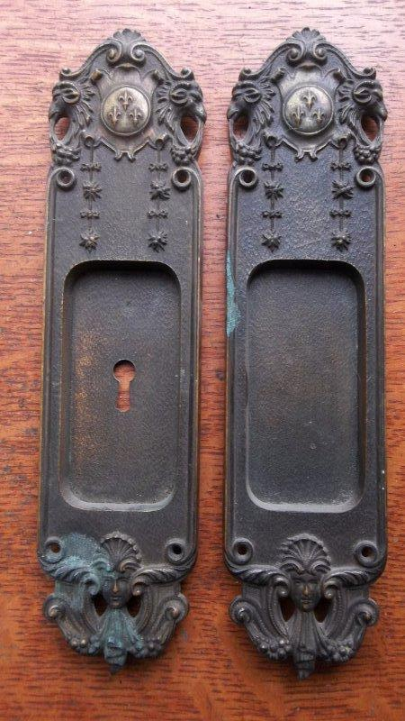 these two charming and unusual pocket door pulls were made around cast bronze the design features fleurdelis at the top with daisy chains and