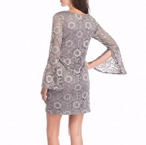 Embrace sweet style with this lace sheath dress! The long bell sleeves add  to the delicate nature of this standout piece. fdcf366e5